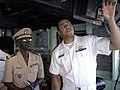 US Navy 090210-N-3316L-077 Lt. j.g. Leonard Green Green a Senegal Navy captain a tour of the bridge of the amphibious transport dock ship USS Nashville (LPD 13).jpg