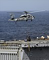 US Navy 090523-N-5345W-183 An MH-60S Sea Hawk helicopter assigned to the Sea Knights of Helicopter Combat Support Squadron (HSC) 22 delivers a load of stores to the flight deck of the amphibious transport dock ship USS Ponce (L.jpg