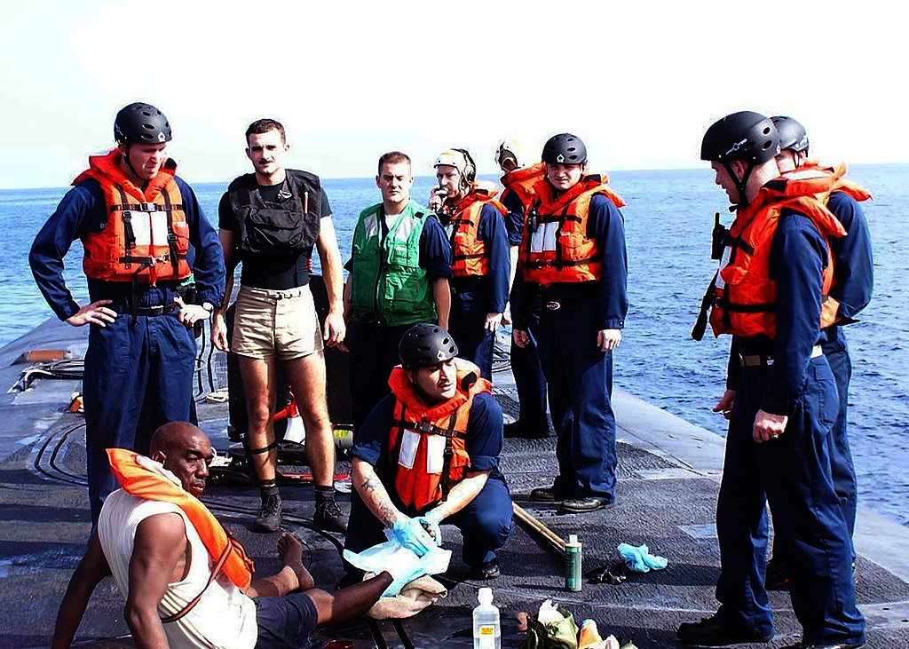 US Navy 090811-N-0000X-062 Sailors aboard the ballistic missile submarine USS Rhode Island (SSBN 740) render aid to five Bahamian nationals recovered from a capsized fishing vessel in the Atlantic Ocean.jpg