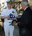 US Navy 090915-N-6220J-010 Commanding Officer of the Ohio-class fleet ballistic-missile submarine USS Nevada (SSBN 733) Cmdr. Marc Behning, presents an American flag flown on Sept. 11 aboard the USS Nevada, to Nevada Gov. Jim G.jpg