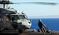 US Navy 100127-N-7508R-177 A Sailor carries a chock and chain to secure an MH-60S Sea Hawk helicopter assigned to Helicopter Sea Combat squadron (HSC) 22.jpg