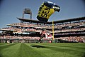US Navy 100412-N-6003P-341 Aircrew Survival Equipmentman 1st Class Thomas Kinn parachutes into Citizens Bank Park with a Phillies flag during the opening ceremony of the Philadelphia Phillies 2010 season.jpg