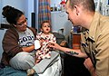 US Navy 100429-N-1522S-002 Machinist's Mate 3rd Class Patrick Gillum, visits with a child at the Joe Dimaggio Children's Hospital in Hollywood, Fla., as part of Fleet Week Port Everglades.jpg