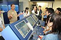 US Navy 100812-N-3283P-010 Capt. Curtis J. Gilbert, commanding officer of Afloat Training Group Western Pacific (ATGWP), explains to Japanese college students the purpose of the navigation simulator during a tour of the command.jpg