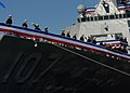 US Navy 101120-N-3737T-219 Sailors man the rails as the ship is brought to life during the commissioning ceremony for the U.S. Navy's newest guided.jpg