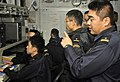 US Navy 101204-N-7103C-015 Military officials from the Japan Maritime Self-Defense Force communicate with Japanese ships in the joint forces air co.jpg