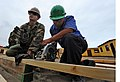 US Navy 101207-N-7589W-054 Builder 2nd Class Andras Toth, left, assigned to Naval Mobile Construction Battalion (NMCB) 28.jpg