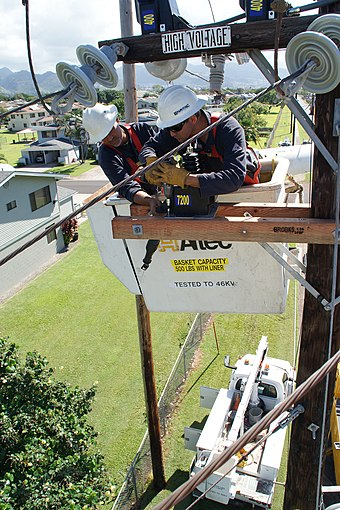 Working on high voltage power lines US Navy 110315-N-0278E-002 High-voltage electricians from Naval Facilities Engineering Command (NAVFAC) Hawaii reconfigure electrical circuitry and.jpg
