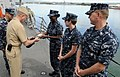 US Navy 110418-N-VM928-041 Master Chief Petty Officer of the Navy (MCPON) Rick D. West is presented with a command ball cap and plaque from Sailors.jpg