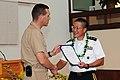US Navy 110518-N-KT462-689 Rear Adm. Dixon R. Smith presents presents Maj. Gen. Stephen Tom with a letter of appreciation.jpg