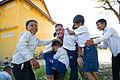 US Navy 111212-M-IS773-031 Children climb on Maj. Brad Ward at an elementary school.jpg