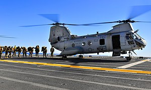 US Navy 120208-N-KB563-471 Marines from the 15th Marine Expeditionary Unit (15th MEU) board a CH-46 Sea Knight helicopter aboard the amphibious ass.jpg