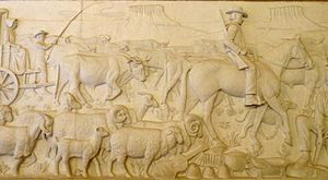 Great Trek - A stone relief depiction of the exodus of farmers from the Cape Colony at the Voortekker Monument.