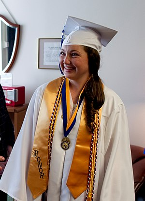 "Academic stole - High-school valedictorian wearing gold academic stole (marked ""honor"")"