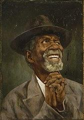 Negro Sorridente com Chapéu Mãos Cruzadas