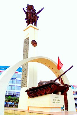 Memorial commemorating the 1974 Buon Me Thuot campaign, depicting a Montagnard of the Central Highlands, a NVA soldier and a T-54 tank Victory Central Highlands.jpg