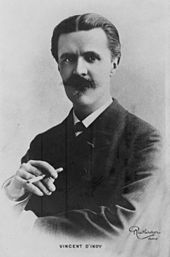 Head and upper body portrait of a middle-aged man with dark hair and heavy moustache, holding a cigarette in his right hand