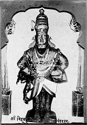 Vithoba - A 1922 photograph of the Vithoba icon in Pandharpur adorned with jewellery and clothes.
