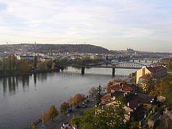 Vltava River Smichov and Petrin as seen from Vysehrad.jpg