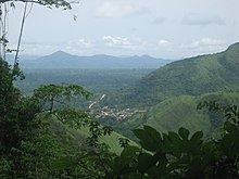 The Volta Region as depicted is lush green, covered in mountains, forests, farmland, and a small town in a valley in the center