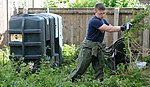 Volunteers help clear garden for local disabled homeowner 120825-F-UA873-351.jpg