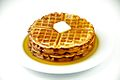 Waffles with maple syrup and butter on a white plate.jpg