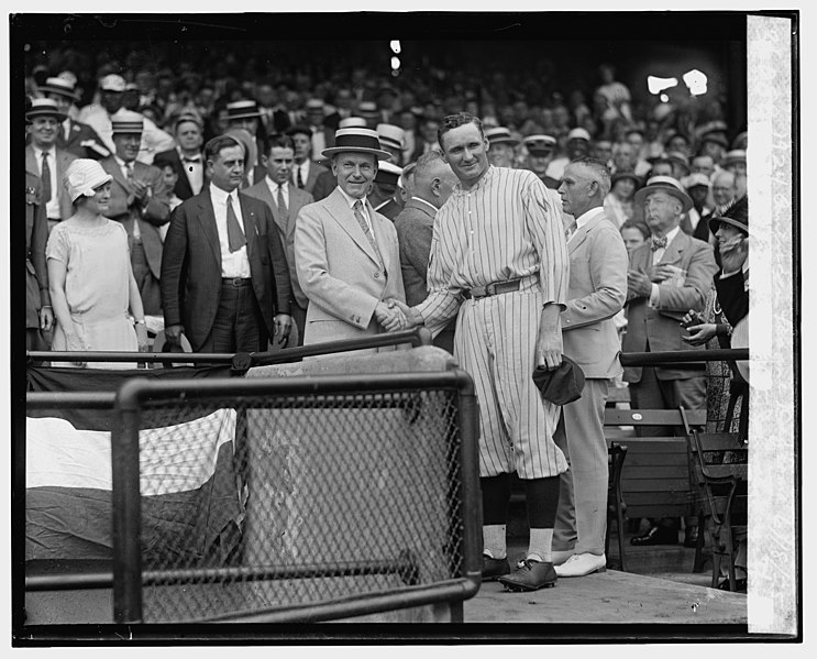 US President Calvin Coolidge and Washington Senators pitcher Walter Johnson shake hands.