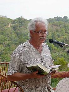 William Deverell reading in Manuel Antonio, Costa Rica, to raise funds for a library.