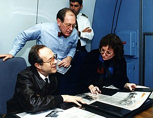 William Perry - Perry and Assistant Secretary of Defense for Public Affairs Kenneth Bacon and Linda Kozaryn, American Forces Press Service reporter, during a flight to Europe, 1995