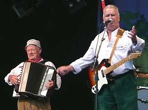 The Wurzels - Tommy Banner and Pete Budd performing at the 2011 Wychwood Festival