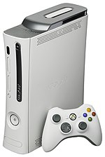 A white Xbox 360 console and controller.