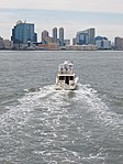 Yacht against Jersey City skyline August 2012.jpg