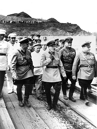Genrikh Yagoda (middle) inspecting the construction of the Moscow-Volga canal. Behind his right shoulder is young Nikita Khrushchev. Yagoda kanal Moskva Volga.jpg