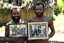 Yaohnanen Tribesmen Show Pictures of 2007 Visit with Prince Philip.jpg
