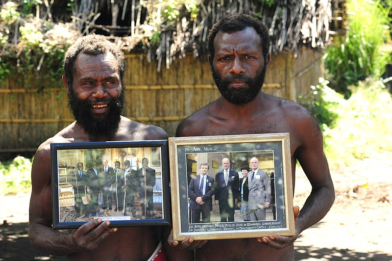 File:Yaohnanen Tribesmen Show Pictures of 2007 Visit with Prince Philip.jpg
