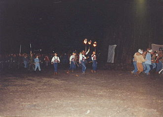 Aggie Bonfire - Yell Leaders and the Fightin' Texas Aggie Band follow the Redpots around the bonfire prior to Burn in 1992.