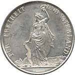 Helvetia standing, holding wreath aloft in left hand, supporting coat of arms of Zürich in right. Gears and crops at feet. Legend along edge.