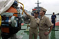001005-N-YM689-026.SINGAPORE, (October 5, 2000) -- Commander Lee Hall, Commanding Officer of the U.S. Navy's Deep Submergence Unit briefs Capt. Jungdo Kim, Commanding Officer of the Korean submarine Choi Moo Sun 001005-N-YM689-026.jpg