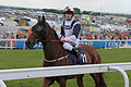 026 Epsom Derby Day - Investec Dash - Confessional and Richard Kingscote going to post (18591311251).jpg