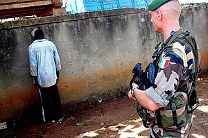 A rebel soldier was caught in the village of Guezon (Ivory Coast) by Foreign Legion troops on 10 August 2004. Along with his teammate, the rebel is beeing interogated by legionnaires before being surrendered to the local police.