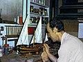 1974-12 Peter Kravchenko with with model shop.jpg