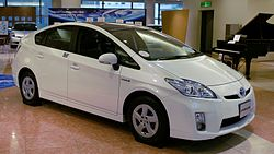 A white Toyota Prius sedan is on display.