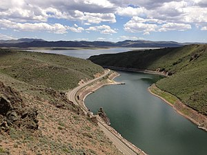 Wild Horse Reservoir - Image: 2013 06 16 13 22 55 Wild Horse Reservoir in Nevada viewed from a rock outcrop above dam, with Nevada State Route 225 along the shore