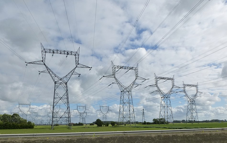 Power lines from Gravelines Nuclear Power Station crossing the A16 motorway, France