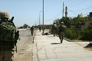 2nd Battalion, 1st Marines - Marines from Echo Company passing the body of an alleged Iraqi insurgent during the First Battle of Fallujah.