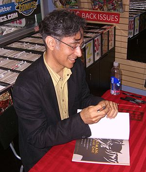 Batman: Year One - David Mazzucchelli autographing a copy of the collected story at a June 28, 2012 signing at Midtown Comics in Manhattan.