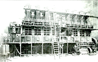 One of the eight-cylinder 3200 I.H.P. Harland and Wolff - Burmeister & Wain diesel engines installed in the motorship Glenapp. This was the highest powered diesel engine yet (1920) installed in a ship. Note man standing lower right for size comparison. 8 cylinder Burmeister & Wain Diesel engine for MS Glenapp 1920.png