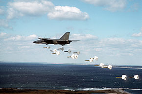 A 509th Bombardment Wing FB-111A aircraft drops Mark 82 high drag practice bombs along a coastline during a training exercise DF-ST-91-02468.jpg