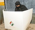 A Muslim female voter casting her vote, at a polling booth during the 3rd Phase of General Elections-2014, in Delhi on April 10, 2014.jpg
