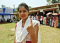 A first time female voter showing indelible ink after casting her vote, at a polling booth, during the 2nd phase of Assam Assembly Election, at Chakardo village, in Kamrup district on April 11, 2016.jpg